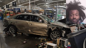 Fired Walmart worker drives car through store, cops say
