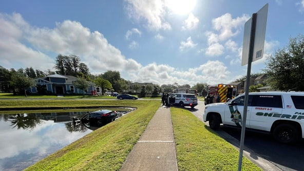 Pasco driver pulled from pond with minor injuries