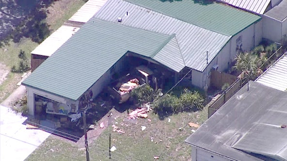 Bomb squad, hazmat respond after truck crashes into Tampa home
