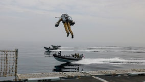 'Undoubtedly impressive': British Marines facilitate jet suit test that allows flight between boats and ships