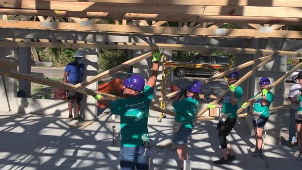 Volunteers help single mother build dream home during Habitat for Humanity's 'Women Build' construction blitz