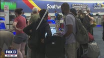 Travelers scramble to reschedule after Southwest cancellations