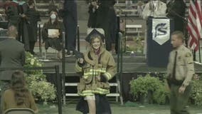 Daughter of firefighter killed in California firehouse shooting wears dad's jacket to high school graduation