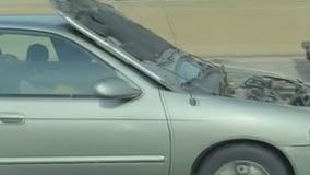 Flipped hood blocks motorist's view while driving miles on I-43