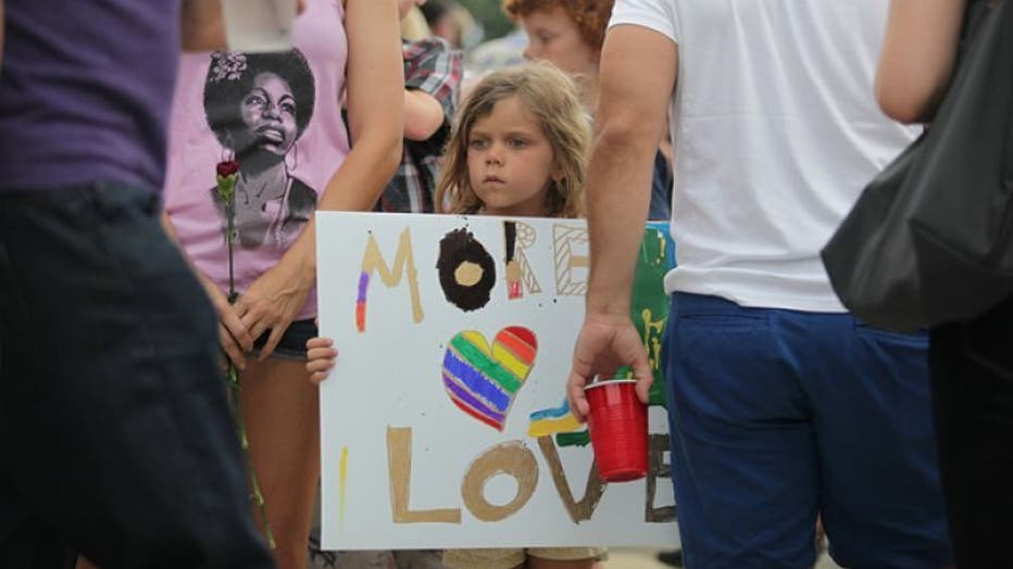 8cfe5362-061316_vigil_for_victims_Dr.20Phillips20Center_Orlando_FL_9_1528773281618.jpg_5653256_ver1.0_640_360.jpg