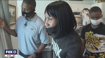 Two families move into new homes, thanks to former Buc Warrick Dunn