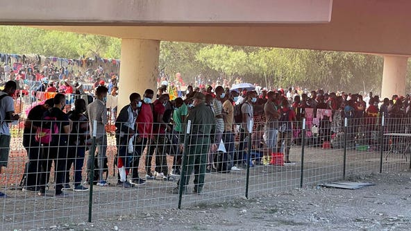 Thousands of migrants sheltering around bridge in small Texas town