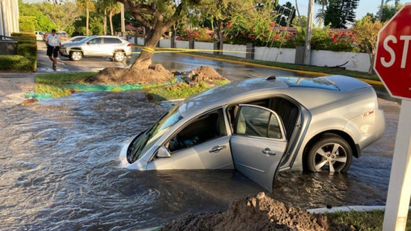 Driver rescued after car plunges into watery hole in Clearwater