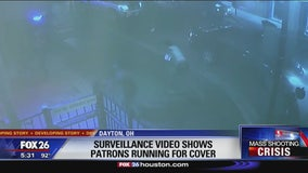 Surveillance video shows patrons running for cover