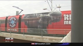 Ride Astros-themed METRORail train