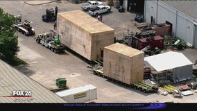 Massive crates being transported from northwest Houston to Bayport terminal