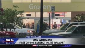 Masked man fires gunshot into the air in Walmart