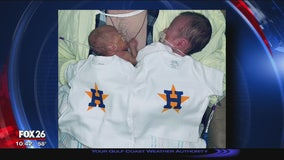 Babies decked out in tiny onesies to cheer on the Astros
