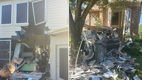 Driver charged after truck plows through Katy house, stopped by tree on the other side