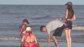 Storm threat not keeping tourists away from Galveston
