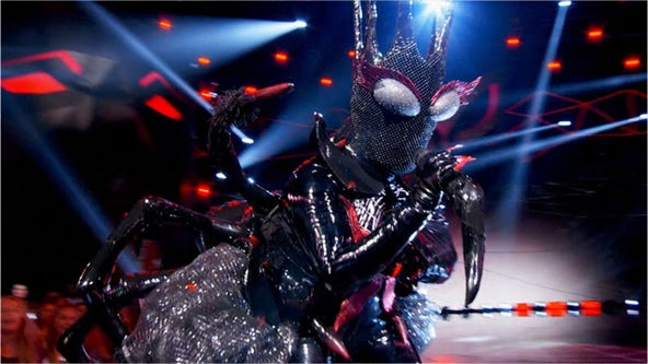 Who is it?: The black widow from Season 2 of 'The Masked Singer' belts Carrie Underwood hit