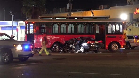 Firefighters cut driver out of car after crash with Galveston trolley