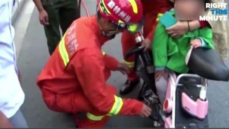Poor Toddler Gets Foot Stuck in Mom's Moped Wheel-407068