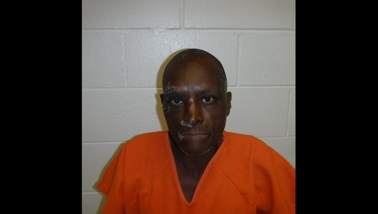 ba47d10d-Charles (MNM) Walker mug shot 2_1511973887954.jpg