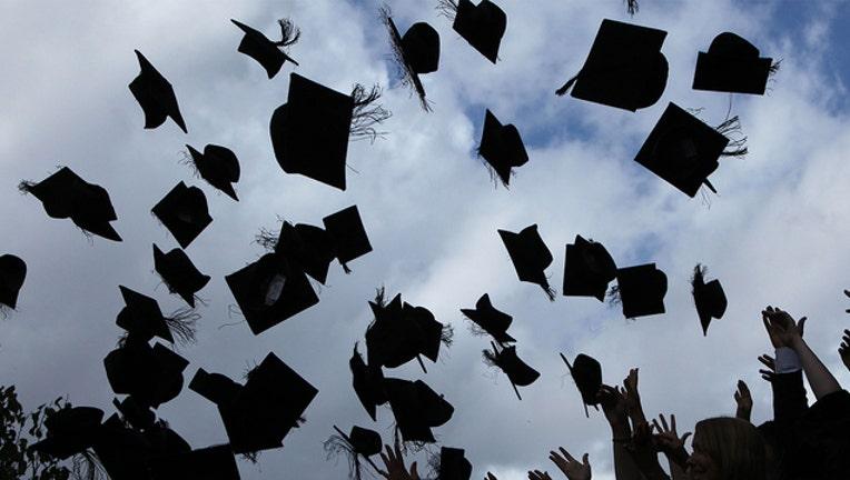 1a21dced-GETTY graduation caps 051319_1557749182738.jpg-401385.jpg