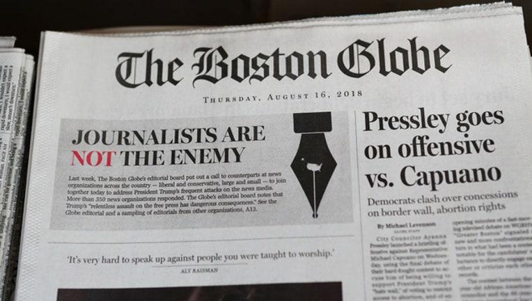 449a76b0-Boston Globe journalists editorials GETTY-409650