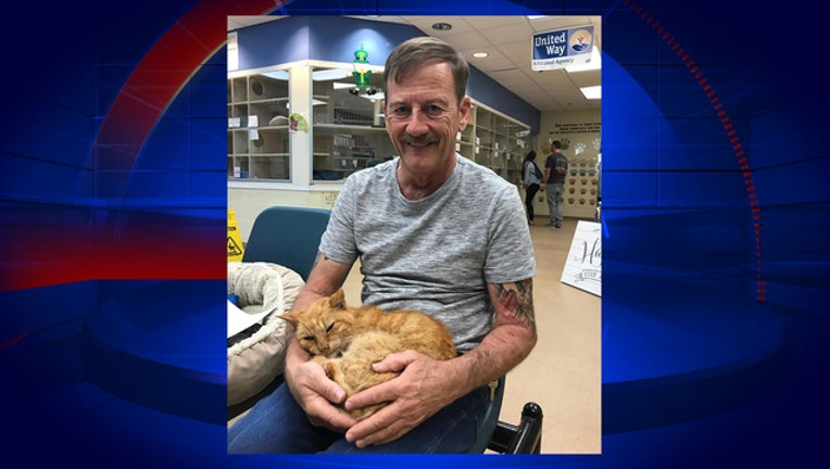 836d1fc3-Perry Martin-reunited-with-cat_1521760908930.jpg-402429.jpg
