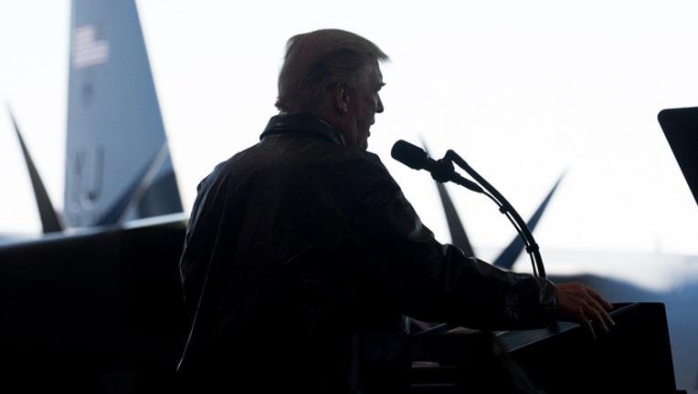 f0e5393b-President Donald Trump Official White House Photo Flickr 080718_1533646519700.jpg-401720.jpg