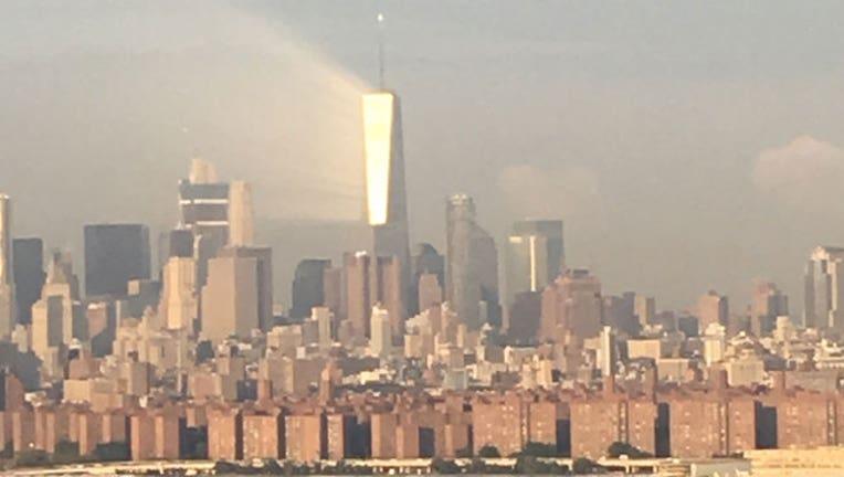 f0f5d5c9-Ray of Light Beams Off 1 WTC-402970