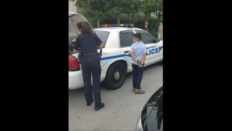 615cd09c-handcuffedboy2_1517252104188.JPG