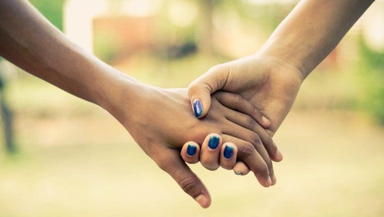 1672ed95-holding_hands_generic_01_032619_1553605613832-401096-401096.jpg
