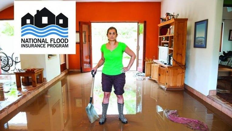 79c2ceaf-nfip_flood_lady_room_fs_logo3_1556744441139.jpg