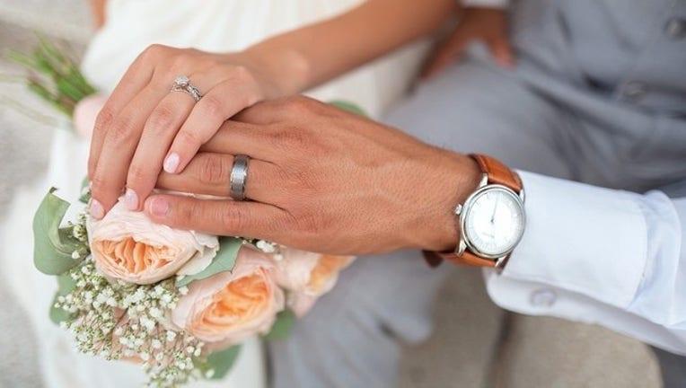 91add7b4-pixabay wedding_1557782867569.jpg.jpg