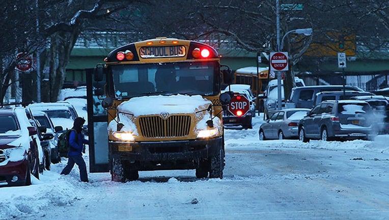 e7617a18-snow and school bus GETTY_1532721651547.jpg-403440.jpg