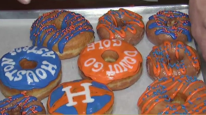 Hugs and Donuts celebrating Houston Astros win
