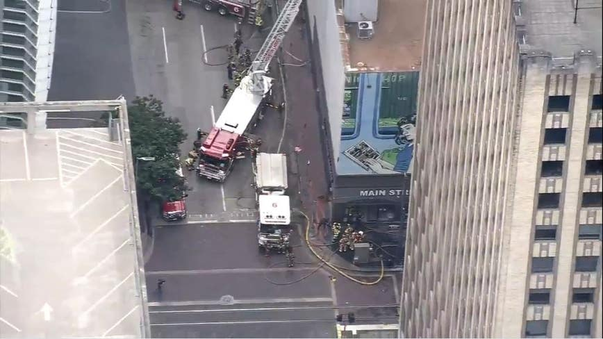 Firefighters battle 4-alarm fire at Main Street Market in downtown Houston