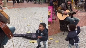 Toddler becomes lonely street musician's number one fan in adorable video