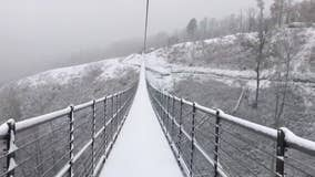 Stunning snowfall on suspension bridge in Tennessee's Great Smoky Mountains