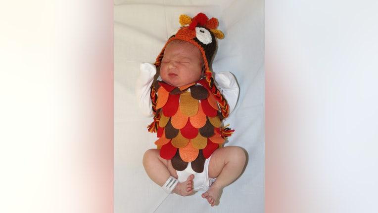 Kenzie is dressed as a turkey.