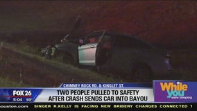 2 people pulled from burning car after crash
