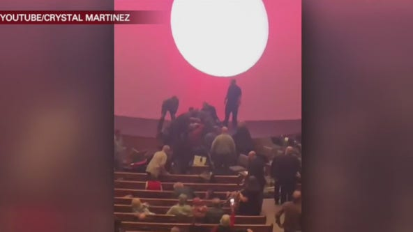 Man arrested after rushing church stage, church member takes him down with music stand