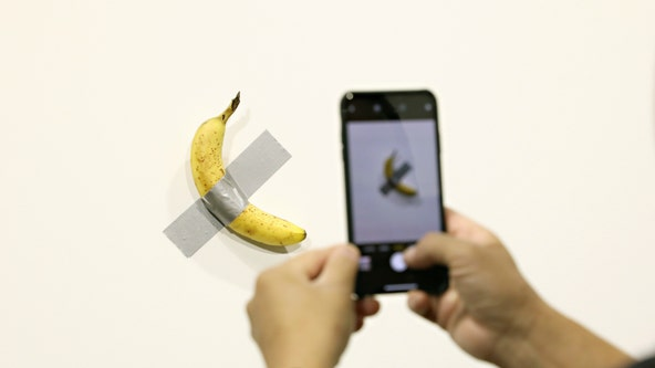 Man grabs $120,000 banana duct taped to wall in art project and eats it