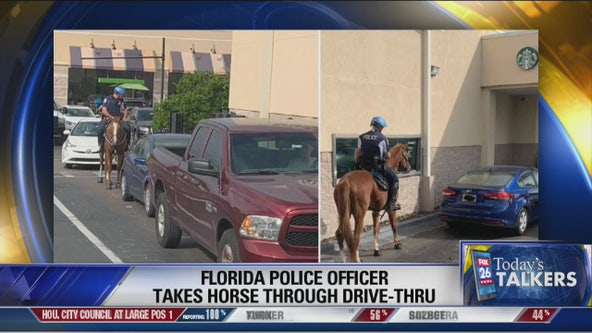 Florida police officer waits at the ride-thru line