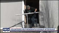 Volunteers clean up after deadly plant explosion
