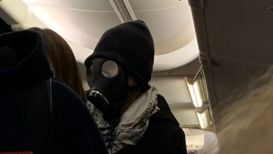 Gas mask on airplane