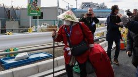 Hundreds of passengers begin leaving after cruise ship's coronavirus quarantine ends