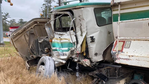 Train crashes into dump truck stuck on railroad tracks in Spring