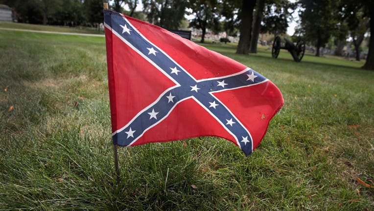 A Confederate flag is shown in the grass.(Photo by Scott Olson/Getty Images)