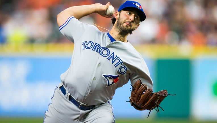 Toronto Blue Jays starting pitcher Mike Bolsinger (49) delivers the pitch in the fourth inning of a MLB game between the Houston Astros and the Toronto Blue Jays at Minute Maid Park, Friday, August 4, 2017. Houston Astros defeated Toronto Blue Jays 16-7.