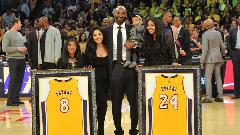 LOS ANGELES, CA - DECEMBER 18: Kobe Bryant, wife Vanessa Bryant and daughters Gianna Maria Onore Bryant, Natalia Diamante Bryant and Bianka Bella Bryant attend Kobe Bryant's jersey retirement ceremony during halftime of a basketball game between the Los Angeles Lakers and the Golden State Warriors at Staples Center on December 18, 2017 in Los Angeles, California. (Photo by Allen Berezovsky/Getty Images)