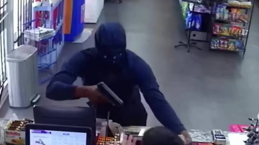 Suspect wanted for robbing Houston food store at gunpoint